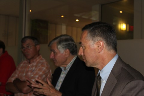 Professor Richard Locke (right) addresses the group as Governor Michael Dukakis (center) and Professor Thomas Kochan listen on.